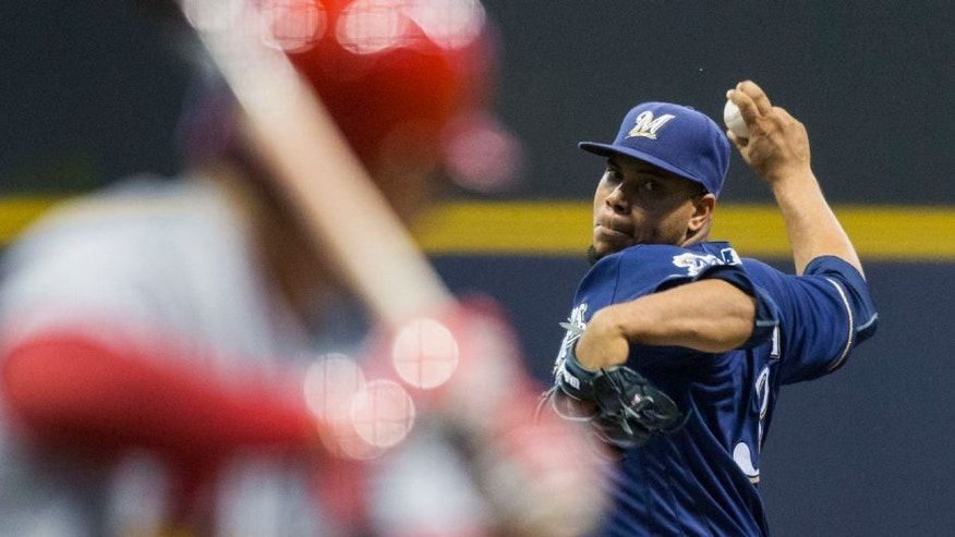 <p>Tuesday, May 31: Milwaukee Brewers' Wily Peralta pitches to a St. Louis Cardinals batter during the first inning.</p>