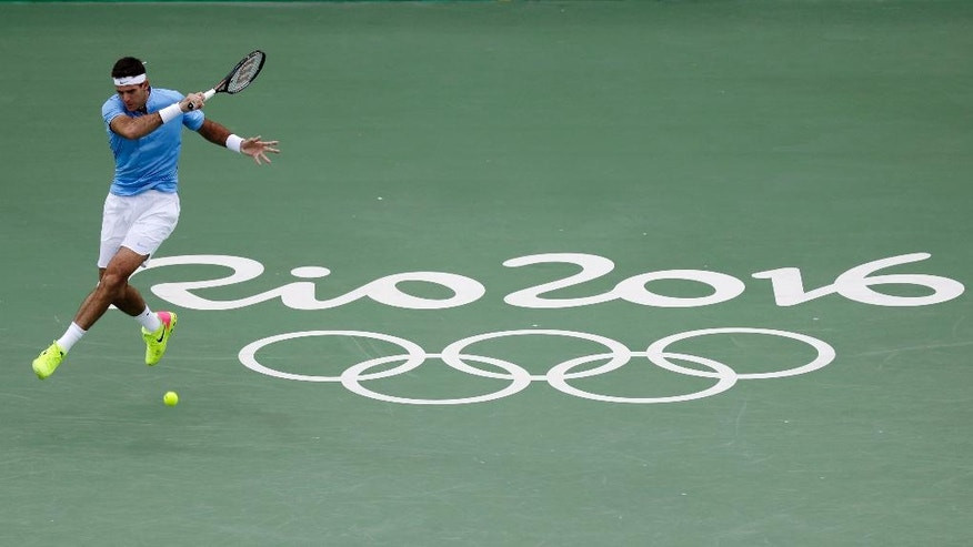 Juan Del Potro of Argentina returns to Joao Sousa of Portugal during the men's singles tennis competition of the 2016 Summer Olympics in Rio de Janeiro, Brazil, Monday, Aug. 8, 2016. (AP Photo/Gregory Bull)