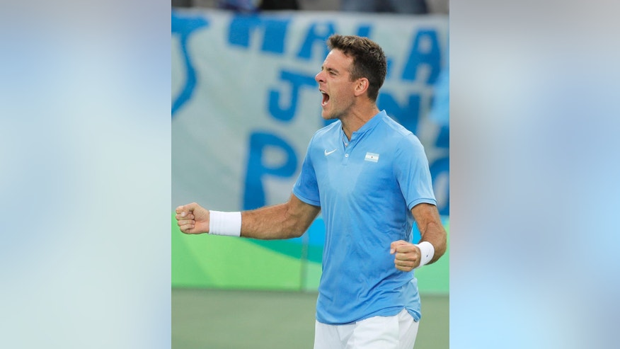 Juan Martin del Potro, of Argentina, celebrates after defeating Portugal's Joao Sousa in the men's tennis competition at the 2016 Summer Olympics in Rio de Janeiro, Brazil, Monday, Aug. 8, 2016. (AP Photo/Vadim Ghirda)