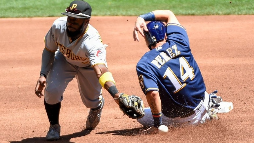 <p>Milwaukee Brewers' Hernan Perez, right, steals second base as the ball gets past Pittsburgh Pirates second baseman Josh Harrison during the first inning of a baseball game Sunday, July 31, 2016, in Milwaukee. (AP Photo/Benny Sieu),Milwaukee Brewers' Hernan Perez, right, steals second base as the ball gets past Pittsburgh Pirates second baseman Josh Harrison, left, during the first inning of a baseball game Sunday, July 31, 2016, in Milwaukee. (AP Photo/Benny Sieu)</p>