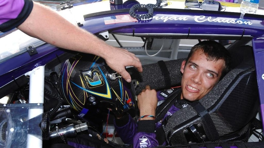 "FILE - In this Oct. 4, 2007, file photo, Bryan Clauson smiles in his car during qualifying for the ARCA RE/MAX Series 250 auto race, at Talladega Superspeedway in Talladega, Ala.  Clauson, considered the top dirt-track racer in the country, has died from injuries suffered in an accident at the Belleville (Kansas) Midget Nationals USAC midget race. He was 27. His death was announced Monday morning at Indianapolis Motor Speedway. A statement from his family was read that said Clauson died Sunday evening, Aug. 7, 2016, and ""fought to the end."" (AP Photo/Rainier Ehrhardt, File)"