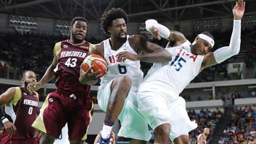 United States' DeAndre Jordan (6) pulls down a rebound between teammate Carmelo Anthony (15) and Venezuela's Nestor Colmenares (43) during a men's basketball game at the 2016 Summer Olympics in Rio de Janeiro, Brazil, Monday, Aug. 8, 2016.