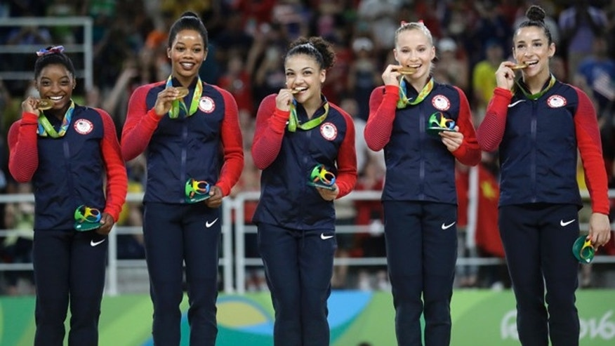 U.S. gymnasts, left to right, Simone Biles, Gabrielle Douglas and Madison Kocian wave to the audience at the end of the artistic gymnastics women's team final at the 2016 Summer Olympics in Rio de Janeiro, Brazil, Tuesday, Aug. 9, 2016.