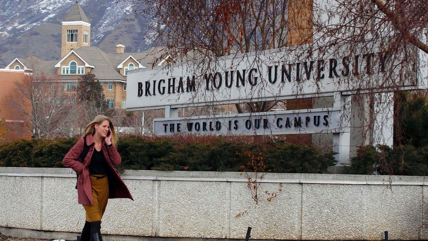 Feb. 17, 2012: A student walks past the entrance of Brigham Young University in Provo.