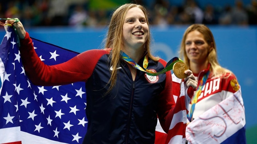 RIO DE JANEIRO, BRAZIL - AUGUST 08: Gold medalist Lilly King of the United States poses during the medal ceremony for the Women's 100m Breaststroke Final on Day 3 of the Rio 2016 Olympic Games at the Olympic Aquatics Stadium on August 8, 2016 in Rio de Janeiro, Brazil. (Photo by Clive Rose/Getty Images)