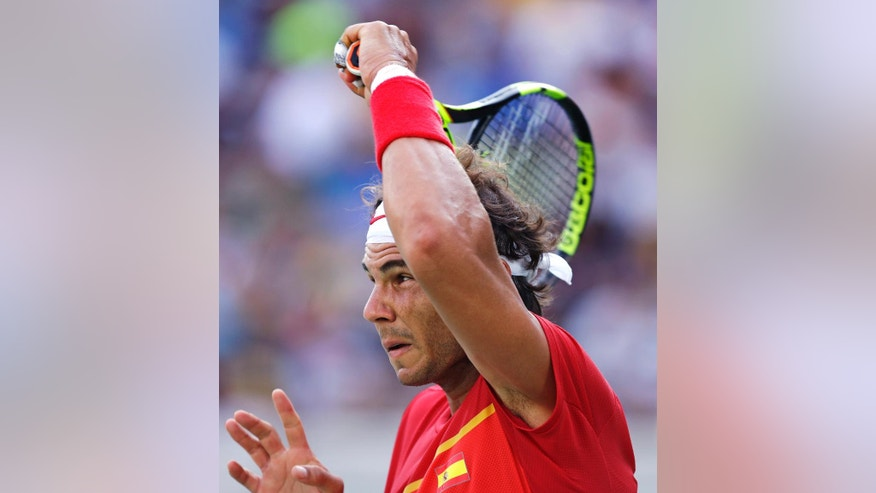 Rafael Nadal, of Spain, returns to Andreas Seppi, of Italy, at the 2016 Summer Olympics in Rio de Janeiro, Brazil, Tuesday, Aug. 9, 2016. (AP Photo/Charles Krupa)