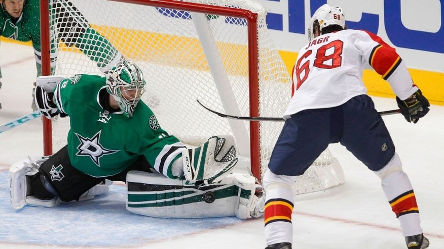 Dallas Stars goalie Kari Lehtonen, left, reaches out to stop the shot from Florida Panthers right wing Jaromir Jagr (44) during the first period of an NHL preseason hockey game Sunday, Sept. 27, 2015, in Dallas. (AP Photo/Tim Sharp)