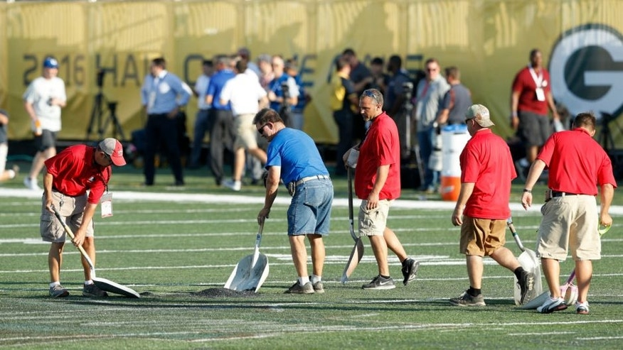 CANTON, OH - AUGUST 07: Crews work on the field prior to the NFL Hall of Fame Game between the Green Bay Packers and Indianapolis Colts at Tom Benson Hall of Fame Stadium on August 7, 2016 in Canton, Ohio. The game was cancelled due to poor field conditions. (Photo by Joe Robbins/Getty Images)