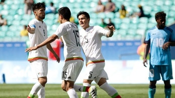 Mexico's Erick Gutierrez, 2nd left, celebrates his goal with teammates Mexico's Oribe Peralta, left, and Mexico's Michael Perez during a group C match of the men's Olympic football tournament between Mexico and Fiji at the Fonte Nova Arena in Salvador, Brazil, Sunday, Aug. 7, 2016. (AP Photo/Arisson Marinho)