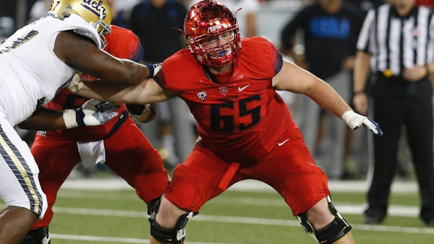 FILE - In this Sept. 26, 2015, file photo, Arizona offensive lineman Zach Hemmila (65) blocks a UCLA player during the first half of an NCAA college football game in Tucson, Ariz.