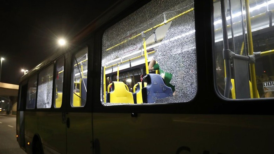 Aug. 9, 2016: This image shows shattered windows on a Olympic media bus that was shot at on a highway in Rio de Janeiro, Brazil