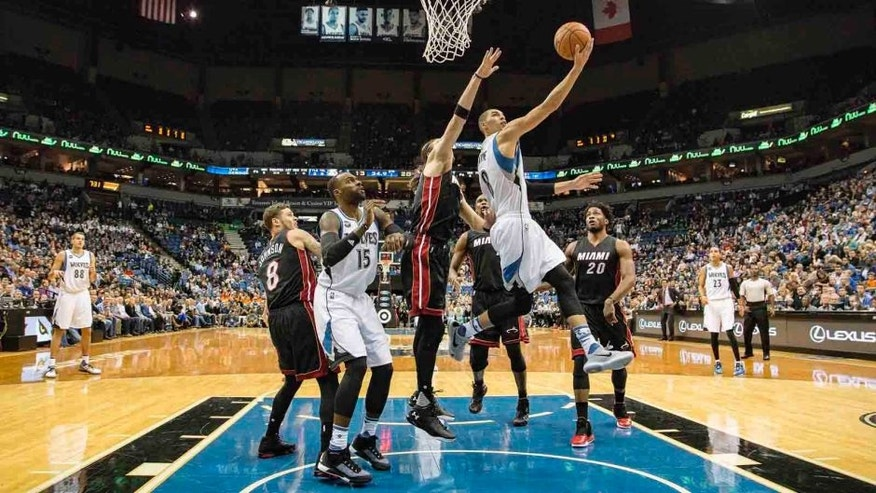 Thursday, Nov. 5, 2015: Minnesota Timberwolves guard Zach LaVine goes up for a layup past Miami Heat forward Josh McRoberts at Target Center in Minneapolis.