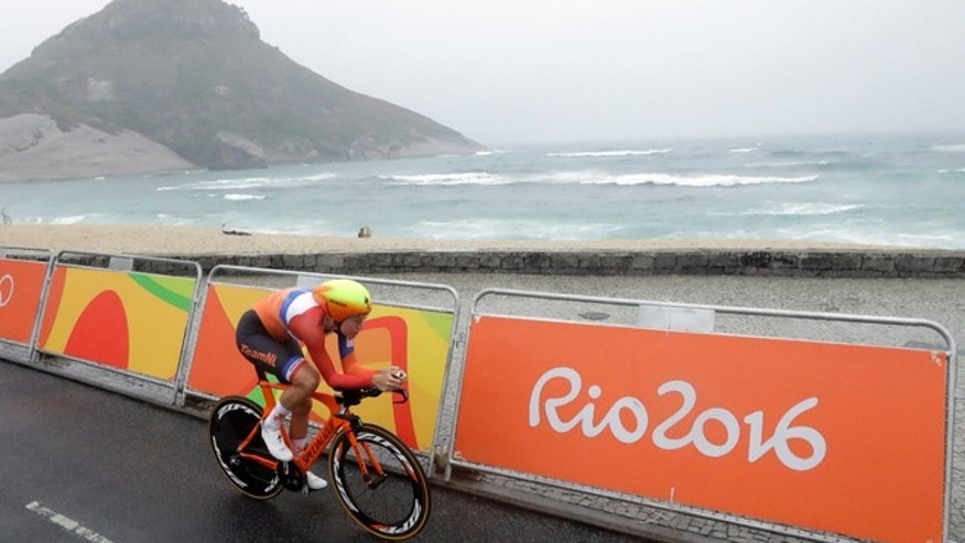 Cyclist Ellen van Dijk of Netherlands rides along Pontal beach during the women's individual time trial event at the 2016 Summer Olympics in Rio de Janeiro, Brazil, Wednesday, Aug. 10, 2016.