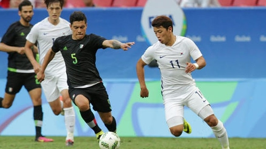 Mexico's Michael Perez, left and South Korea's Hwang Heechan vie for the ball during a group C match of the men's Olympic football tournament between South Korea and Mexico at the National Stadium in Brasilia, Brazil, Wednesday, Aug. 10, 2016. South Korea won the game 1-0. (AP Photo/Eraldo Peres)