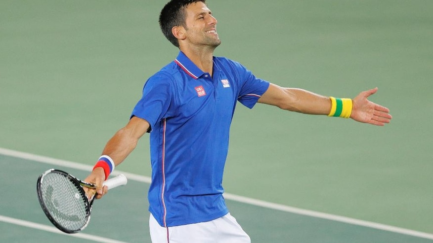 Novak Djokovic, of Serbia, gestures after winning a point against Juan Martin del Potro, of Argentina, in the men's tennis competition at the 2016 Summer Olympics in Rio de Janeiro, Brazil, Sunday, Aug. 7, 2016. (AP Photo/Vadim Ghirda)