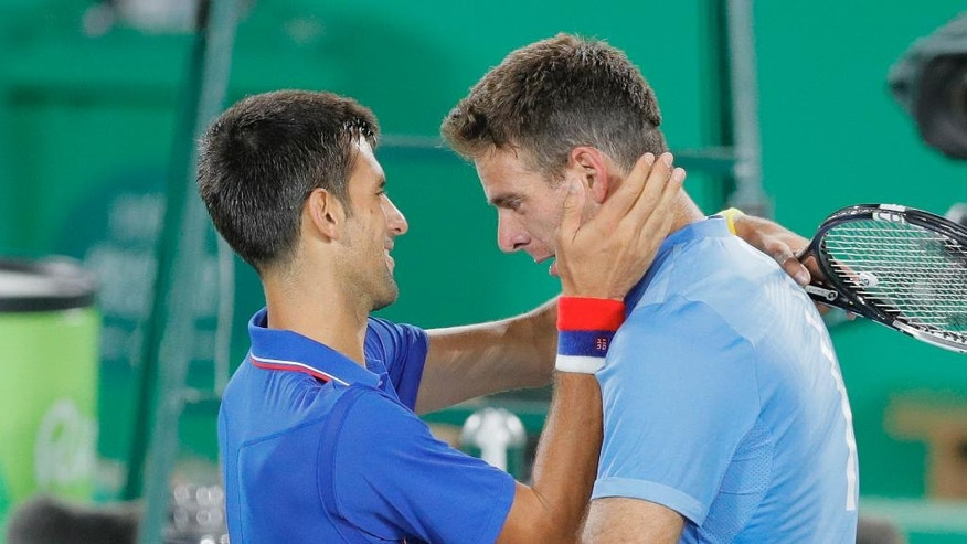 Juan Martin del Potro, of Argentina, cries while hugging Novak Djokovic, of Serbia, after defeating him in the men's tennis competition at the 2016 Summer Olympics in Rio de Janeiro, Brazil, Sunday, Aug. 7, 2016. (AP Photo/Vadim Ghirda)
