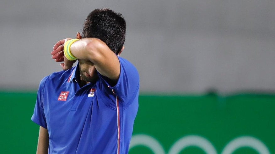 (Olympics) Tearful Djokovic hailed as true champion