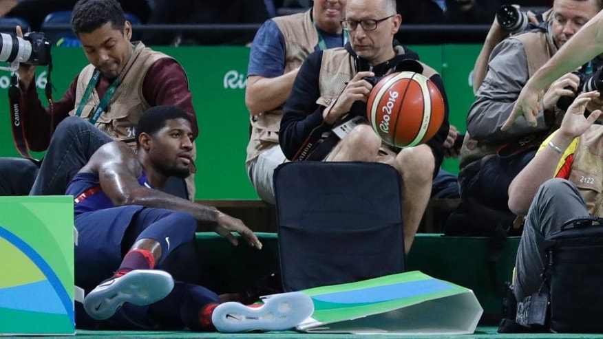 United States' Paul George, left, chases a loose ball out of bounds during a men's basketball game against Australia at the 2016 Summer Olympics in Rio de Janeiro, Brazil, Wednesday, Aug. 10, 2016. (AP Photo/Eric Gay)