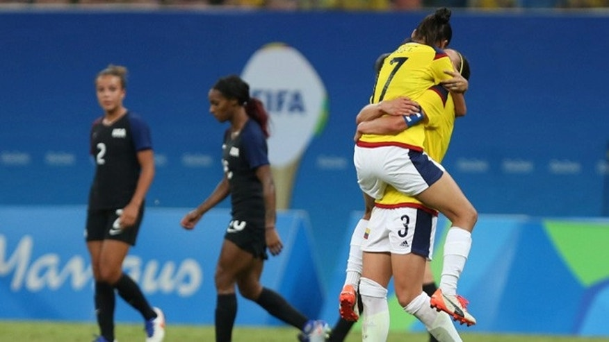 Players of Colombia celebrate at the end of a group G match of the women's Olympic football tournament between Colombia and United States at the Arena Amazonia stadium in Manaus, Brazil, Tuesday, Aug. 9, 2016. The game ended in a 2-2 draw. (AP Photo/Michael Dantas)