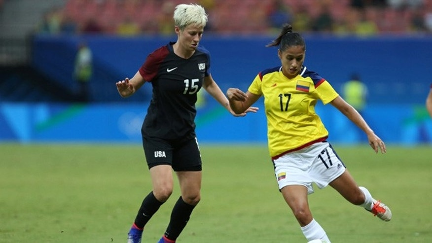 United States' Megan Rapinoe, left and Colombia's Carolina Arias fight for the ball during a group G match of the women's Olympic football tournament between Colombia and United States at the Arena Amazonia stadium in Manaus, Brazil, Tuesday, Aug. 9, 2016. (AP Photo/Michael Dantas)