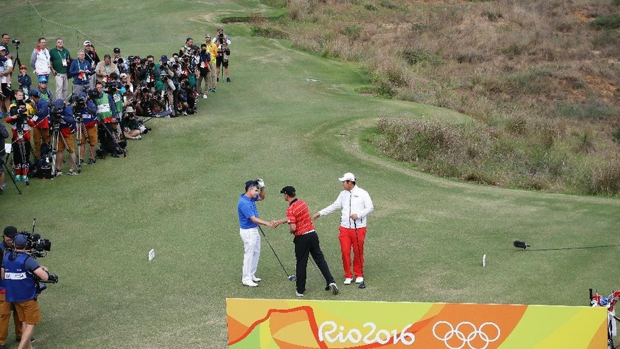 Golfers' Adilson da Silva of Brazil, Graham DeLaet of Canada and Byeong Hun An of South Korea, from left shake hands on the first hole during the first round of the men's golf event at the 2016 Summer Olympics in Rio de Janeiro, Brazil, Thursday, Aug. 11, 2016. (AP Photo/Chris Carlson)