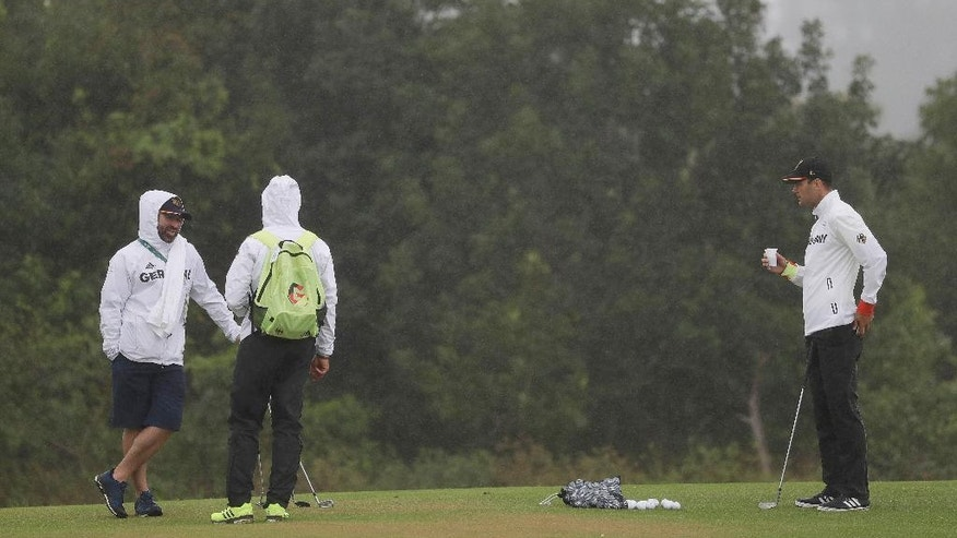 Martin Kaymer, of Germany, take a drink on the chipping green as he prepares for the men's golf event at the 2016 Summer Olympics in Rio de Janeiro, Brazil, Wednesday, Aug. 10, 2016. (AP Photo/Alastair Grant)