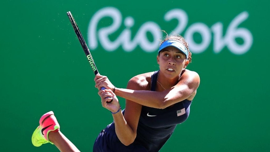 Madison Keys, of the United States, returns to Daria Kasatkina, of Russia, at the 2016 Summer Olympics in Rio de Janeiro, Brazil, Thursday, Aug. 11, 2016. (AP Photo/Charles Krupa)
