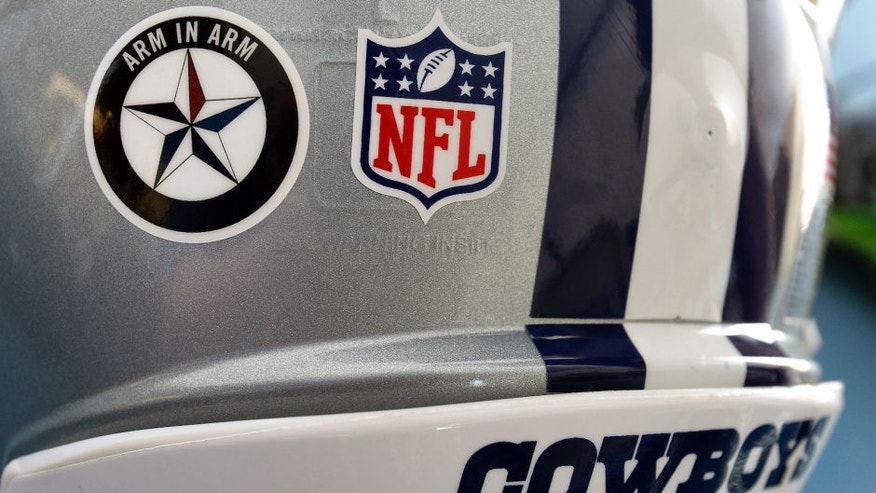 A sticker in support of the Dallas Police department on the Dallas Cowboys' helmets during training camp in Oxnard, Calif., on Saturday, July 30, 2016. (Max Faulkner/Fort Worth Star-Telegram/TNS via Getty Images)
