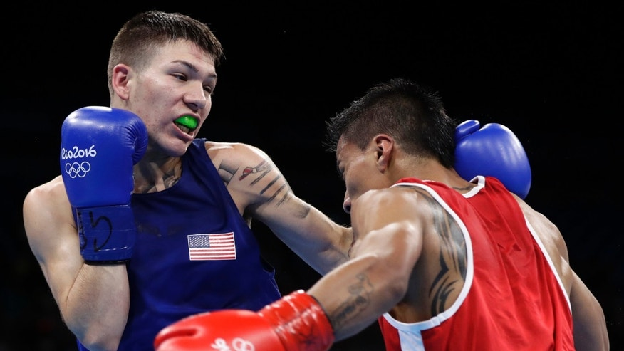 United States' Nico Miguel Hernandez, left, fights Ecuador's Carlos Eduardo Quipo Pilataxi on Aug. 10, 2016.