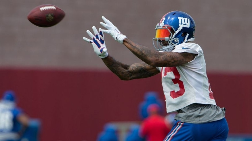 Jul 30, 2016; East Rutherford, NJ, USA; New York Giants wide receiver Odell Beckham (13) catches the ball at Quest Diagnostics Training Center. Mandatory Credit: William Hauser-USA TODAY Sports