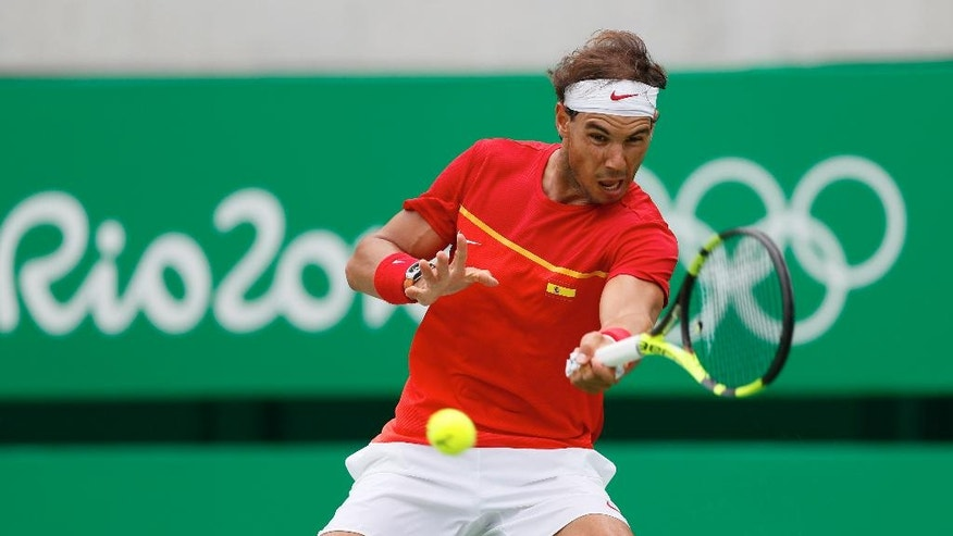 Spain's Rafael Nadal returns to France's Gilles Simon during the men's tennis competition at the 2016 Summer Olympics in Rio de Janeiro, Brazil, Thursday, Aug. 11, 2016. (AP Photo/Vadim Ghirda)