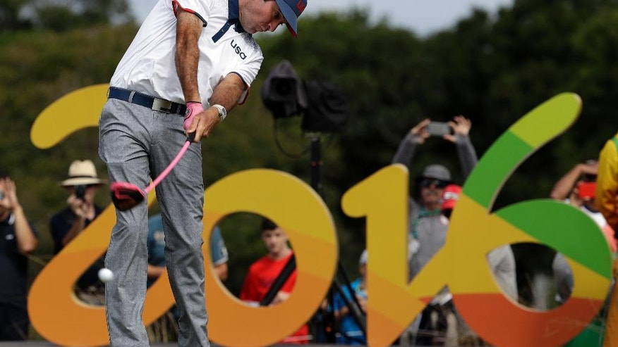Bubba Watson of the United States, tees on the 16th hole during the first round of the men's golf event at the 2016 Summer Olympics in Rio de Janeiro, Brazil, Thursday, Aug. 11, 2016. (AP Photo/Alastair Grant)