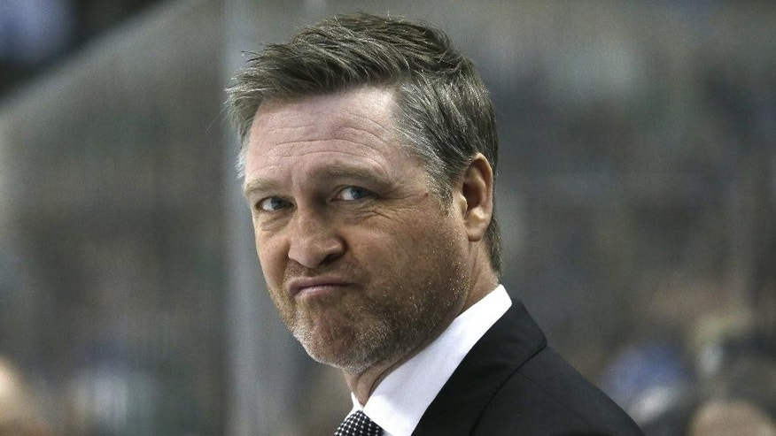 FILE - In this Feb. 3, 2015, file photo, Colorado Avalanche head coach Patrick Roy watches from the bench during the first period of an NHL hockey game against the Dallas Stars, in Dallas. Patrick Roy has stepped down as coach and vice president of hockey operations for the Colorado Avalanche. Roy made the announcement Thursday, Aug. 11, 2016,  through a public relations agency, two months before the start of the NHL regular season.  (AP Photo/LM Otero, File)