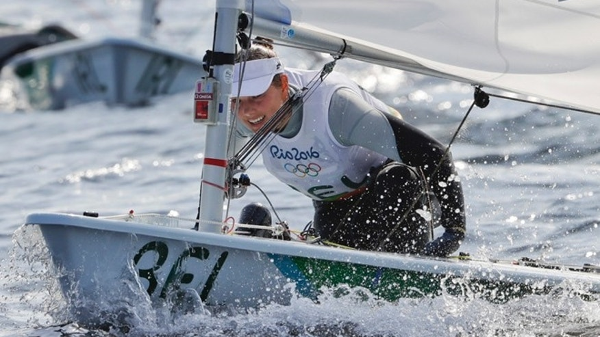 In this picture taken Tuesday, Aug. 9, 2016, Belgium's Evi Van Acker competes during the Laser Radial women event at the 2016 Summer Olympics in Rio de Janeiro, Brazil. Van Acker reported feeling sick after races Wednesday, Aug. 10, the governing body World Sailing said.