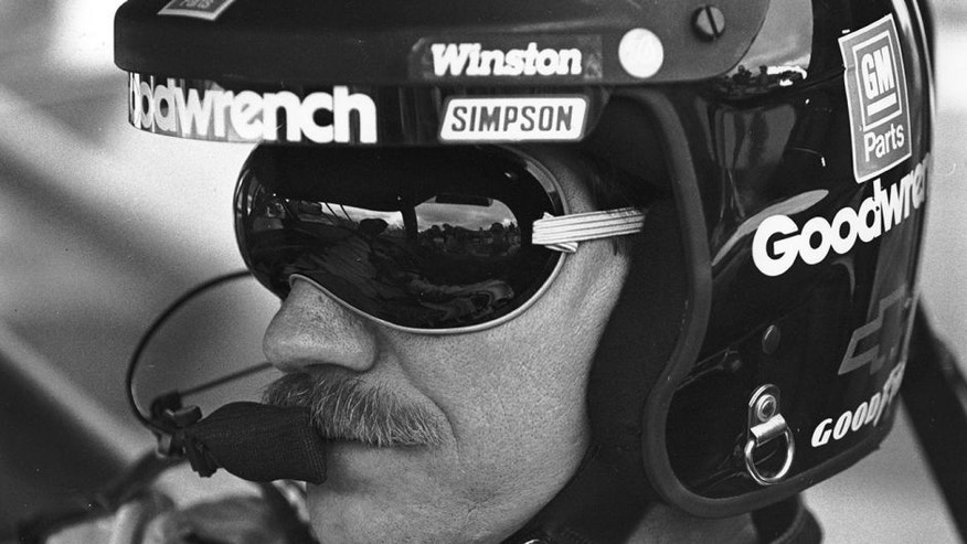 UNKNOWN: Dale Earnhardt, Sr driver of the #3 GM Goodwrench Cheverolet sits in his car before a race circa 1996. (Photo by ISC Archives via Getty Images)