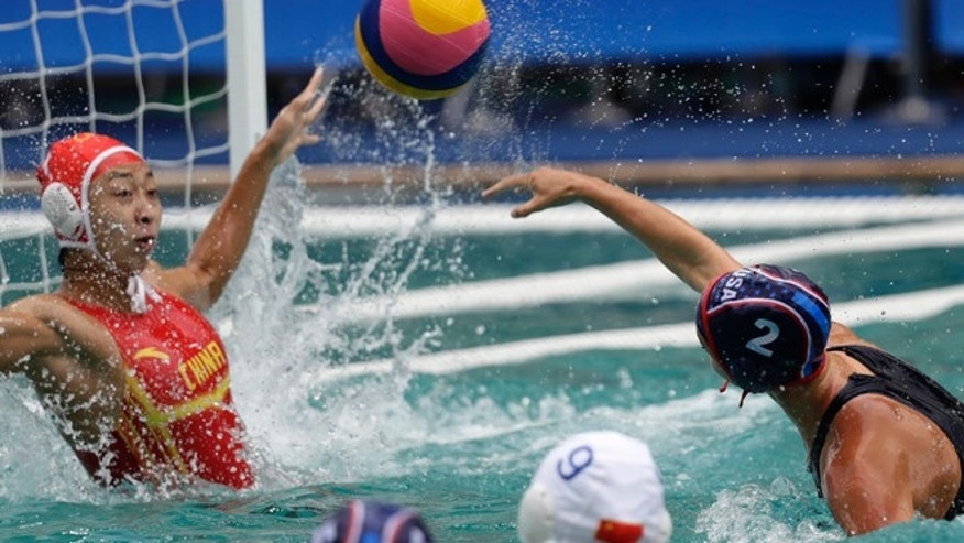 United States' Madeline Musselman, right, shoots and scores against China during women's water polo preliminary round match at the 2016 Summer Olympics in Rio de Janeiro, Brazil, Thursday, Aug. 11, 2016.