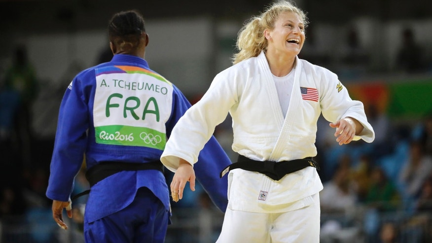 Aug. 11, 2016: United States' Kayla Harrison celebrates her gold medal after defeating France's Audrey Tcheumeo in the women's 78-kg judo gold medal match at the 2016 Summer Olympics in Rio de Janeiro, Brazil.