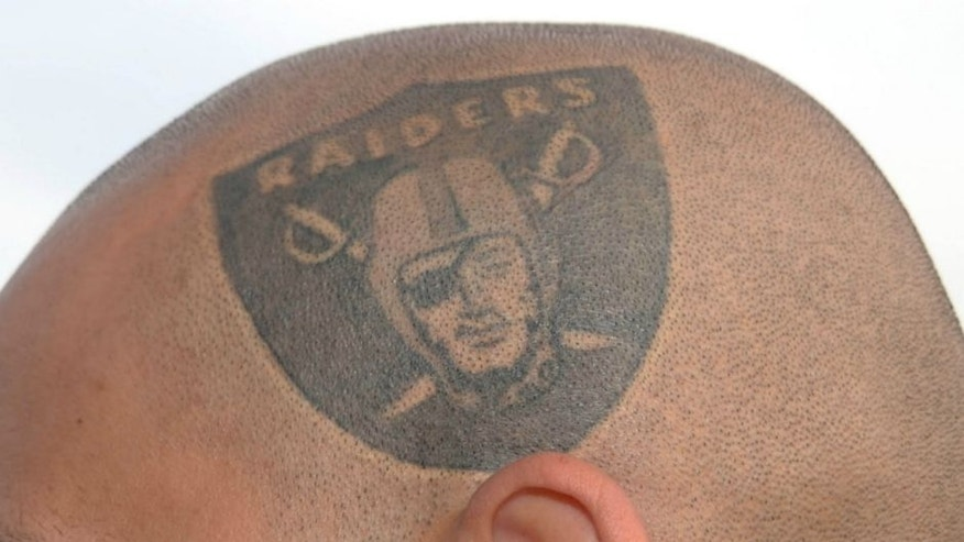 Oct 21, 2012; Oakland, CA, USA; Oakland Raiders fan Rico Espinoza poses with a Raiders tattoo on the side of his head before the game against the Jacksonville Jaguars at O.co Coliseum. Mandatory Credit: Kirby Lee/Image of Sport-US PRESSWIRE