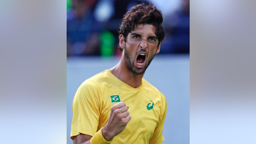 Thomaz Bellucci, of Brazil, pumps his fist after winning a point during their quarter final round match at the 2016 Summer Olympics in Rio de Janeiro, Brazil, Friday, Aug. 12, 2016. (AP Photo/Charles Krupa)
