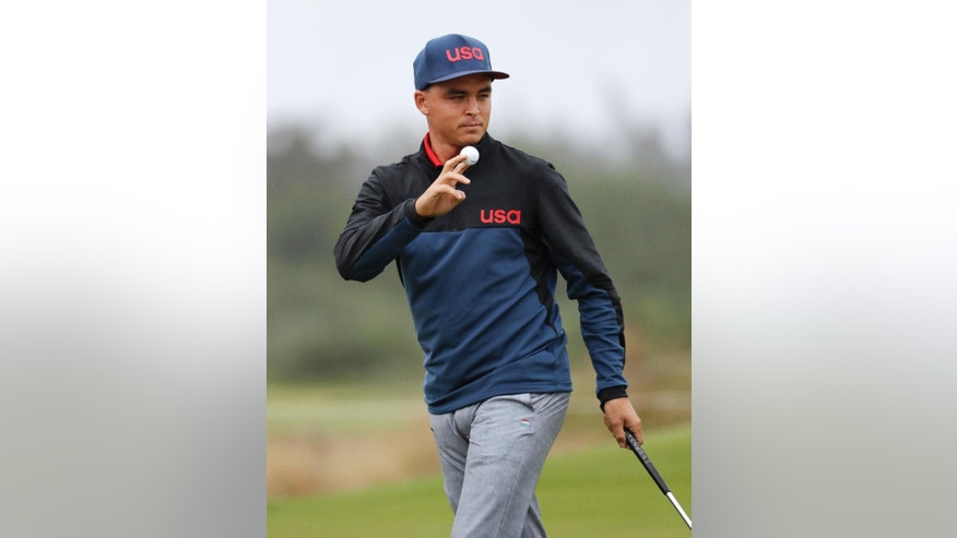 Rickie Fowler of the United States waves after making his putt on the ninth green during the second round of the men's golf event at the 2016 Summer Olympics in Rio de Janeiro, Brazil, Friday, Aug. 12, 2016. (AP Photo/Chris Carlson)
