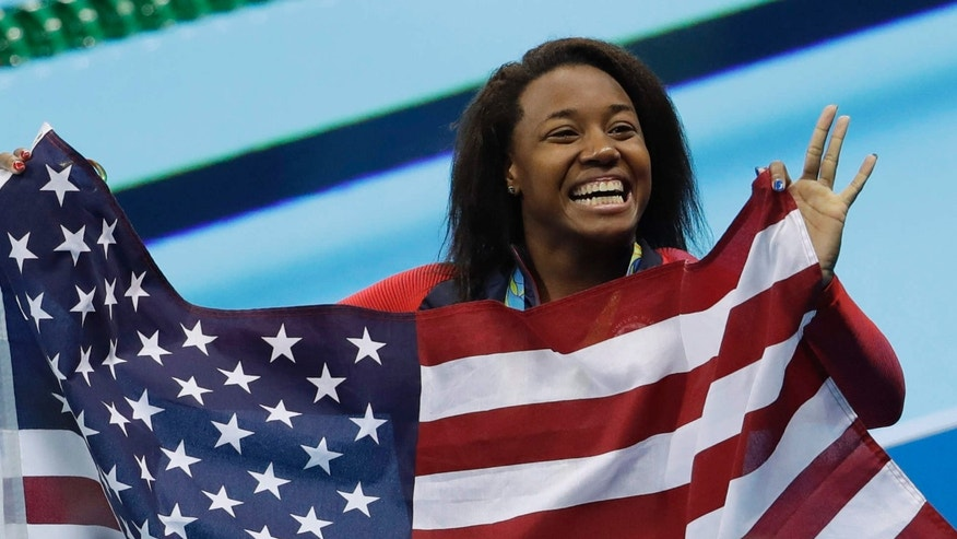 United States' Simone Manuel celebrates winning the gold medal in the women's 100-meter freestyle during the swimming competitions at the 2016 Summer Olympics, Friday, Aug. 12, 2016, in Rio de Janeiro, Brazil.