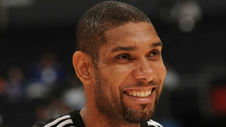 LOS ANGELES - NOVEMBER 17: Tim Duncan #21 of the San Antonio Spurs smiles during warmups prior to a game against the Los Angeles Clippers at Staples Center on November 17, 2008 in Los Angeles, California. NOTE TO USER: User expressly acknowledges and agrees that, by downloading and/or using this Photograph, user is consenting to the terms and conditions of the Getty Images License Agreement. Mandatory Copyright Notice: Copyright 2008 NBAE (Photo by Noah Graham/NBAE via Getty Images)