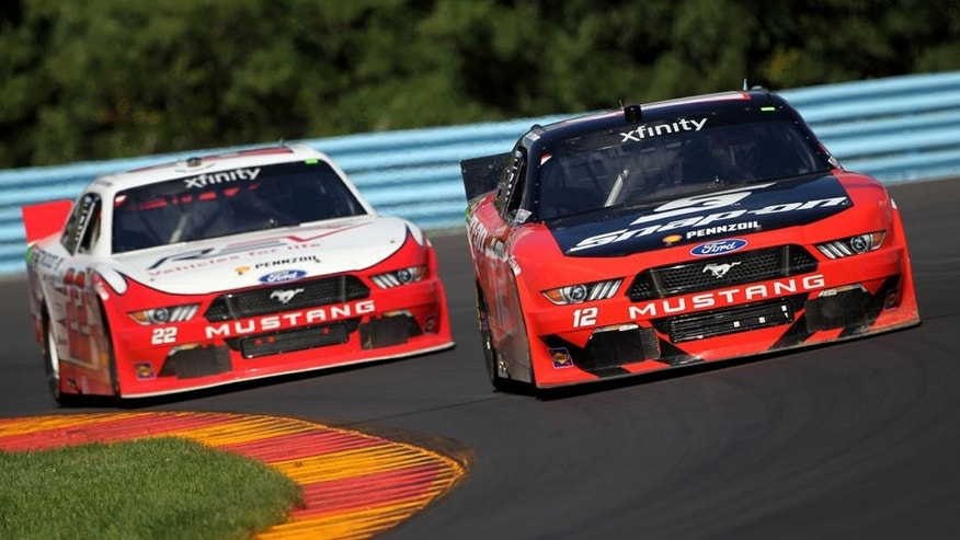 WATKINS GLEN, NY - AUGUST 06: Joey Logano, driver of the #12 Snap-On Ford, races Brad Keselowski, driver of the #22 Fleetwood/REV Group Ford, during the NASCAR XFINITY Series Zippo 200 at Watkins Glen International on August 6, 2016 in Watkins Glen, New York. (Photo by Brian Lawdermilk/Getty Images)