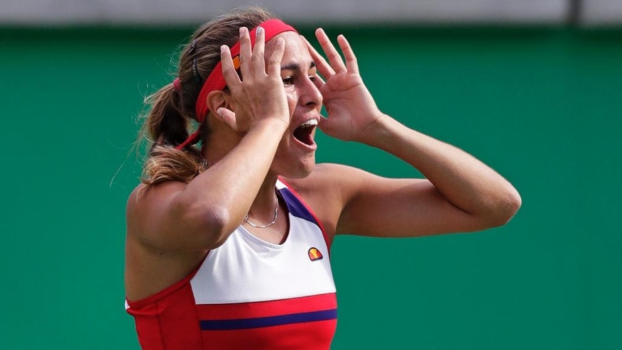 Monica Puig, of Puerto Rico, reacts after defeating Petra Kvitova, of the Czech Republic, during their semi-final round match at the 2016 Summer Olympics in Rio de Janeiro, Brazil, Friday, Aug. 12, 2016. (AP Photo/Charles Krupa)