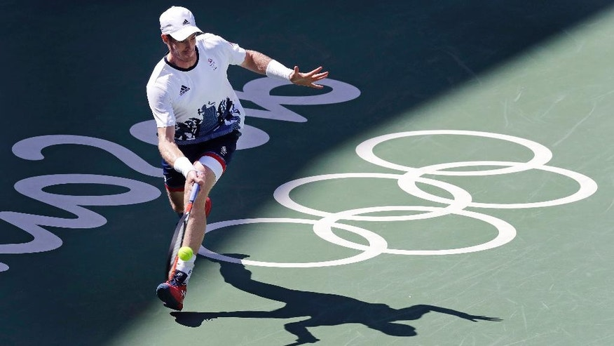 Andy Murray, of England, returns to Kei Nishikori, of Japan, during their semi-final round match at the 2016 Summer Olympics in Rio de Janeiro, Brazil, Saturday, Aug. 13, 2016. (AP Photo/Charles Krupa)