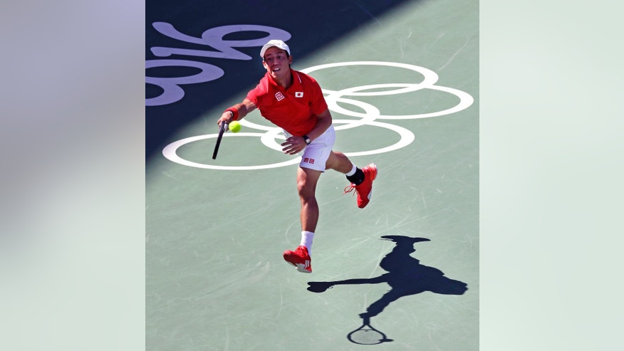 Kei Nishikori, of Japan, returns to Andy Murray, of England, during their semi-final round match at the 2016 Summer Olympics in Rio de Janeiro, Brazil, Saturday, Aug. 13, 2016. (AP Photo/Charles Krupa)