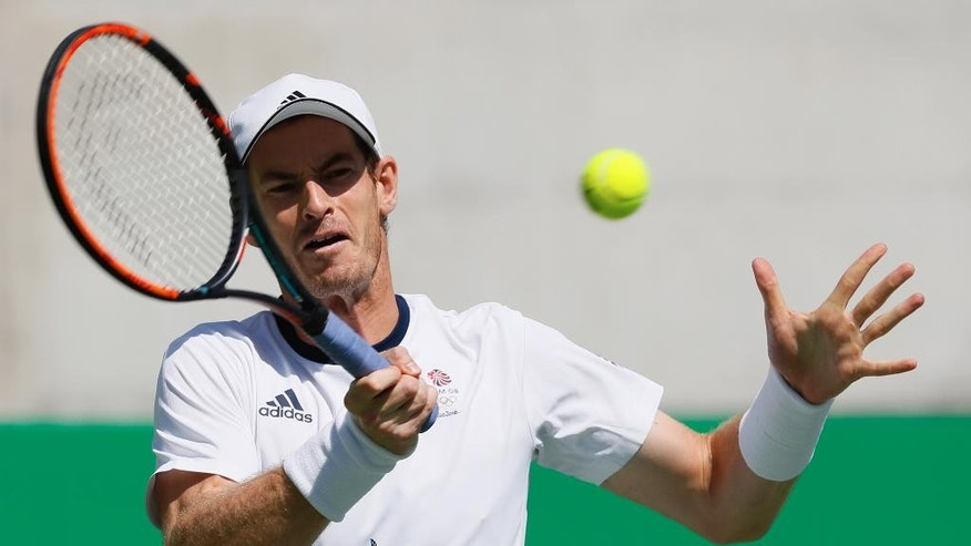 Great Britain's Andy Murray returns to Japan's Kei Nishikori during the semifinals of the men's singles tennis competition at the 2016 Summer Olympics in Rio de Janeiro, Brazil, Saturday, Aug. 13, 2016. (AP Photo/Vadim Ghirda)