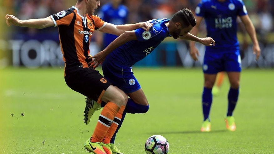 Hull City's Andrew Robertson, left, and Leicester City's Riyad Mahrez in action during their English Premier League soccer match at the KCOM Stadium, Hull, England, Saturday Aug. 13, 2016. (Nigel French / PA via AP)