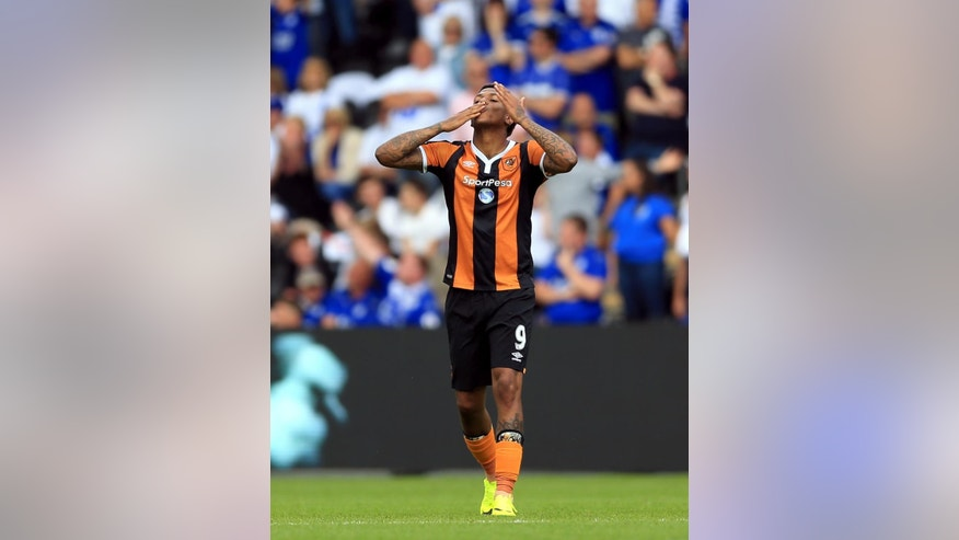 Hull City's Abel Hernandez celebrates scoring his side's first goal against Leicester City of the game during the English Premier League soccer match at the KCOM Stadium, Hull, England, Saturday Aug. 13, 2016. (Nigel French / PA via AP)