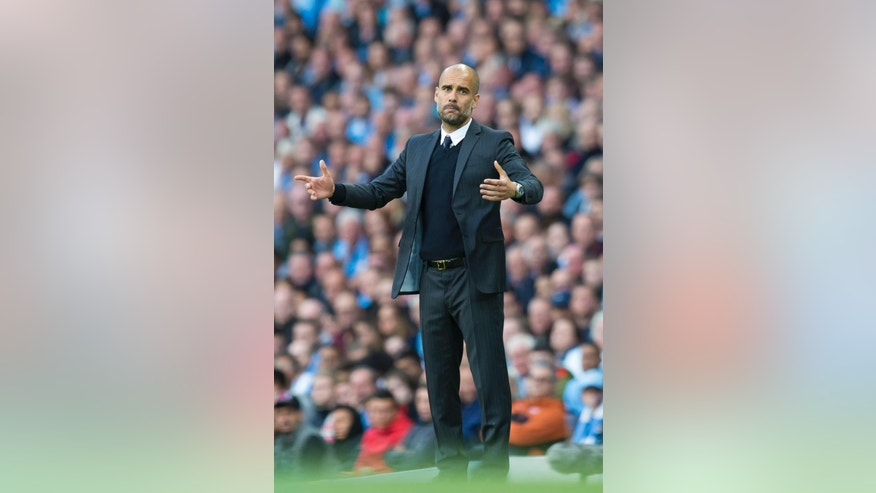 Manchester City's new manager Pep Guardiola reacts after a missed opportunity during the English Premier League soccer match between Manchester City and Sunderland at the Etihad Stadium in Manchester, England, Saturday Aug. 13, 2016. (AP Photo/Jon Super)